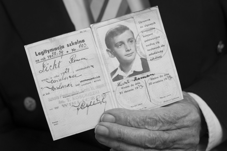 Ron Leaton (83) Cracow Ghetto and Camp Survivor shows his war time ID.