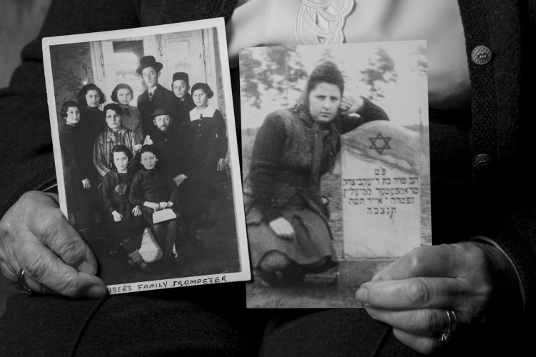 Toby Biber, Holocaust Survivor, holding an old family photo, and a photo of herself at the grave of her older sister who died 8 days after the liberation of Bergen Belsen