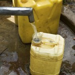 Jerry cans of pumped well water – Nangola Village