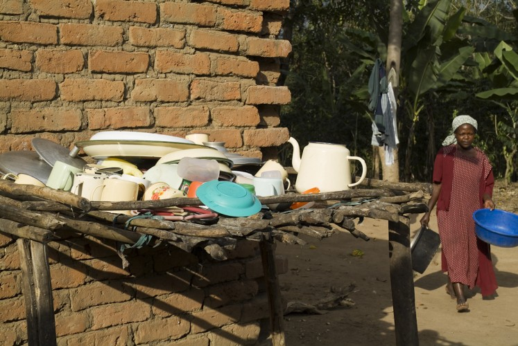 Crockery rack - dishes being dried in the heat of the day. Nangola village.