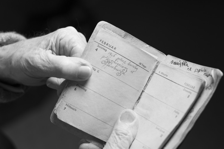 Jurek Cynk, born in Poland 1925. Auschwitz  and Camp Survivor, shows his diary of 1945.